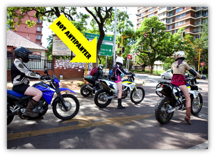 Description: A group of people riding on the back of a motorcycle  Description generated with very high confidence