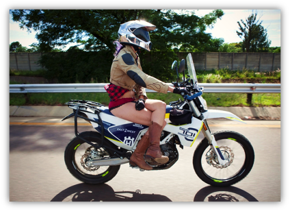 Description: A person riding on the back of a motorcycle  Description generated with very high confidence