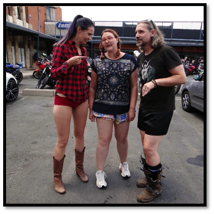 Description: A group of people standing in a parking lot  Description generated with very high confidence