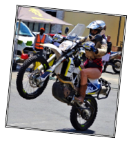 Description: A person flying through the air while riding a motorcycle  Description generated with very high confidence